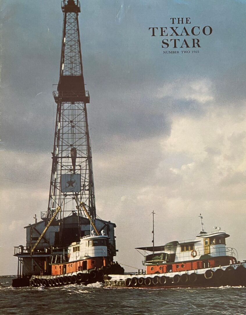 back cover twin tugs and Texaco rig
