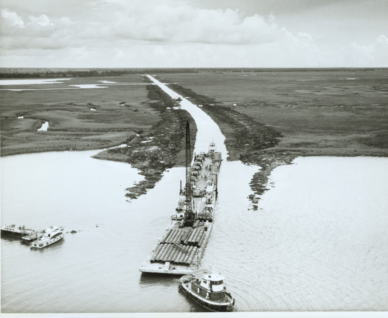 barge loaded with concrete pipe in the Delta_1950s